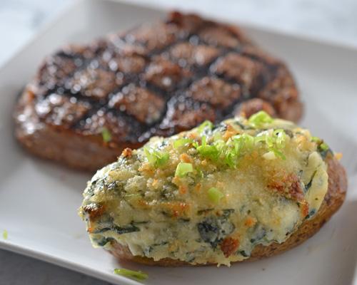 Spinach alfredo twice baked potato with Certified Angus Beef Brand Ribeye Steak