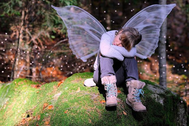 Girl Dressed Up Like a Fairy, Sitting, Waiting, Head Down