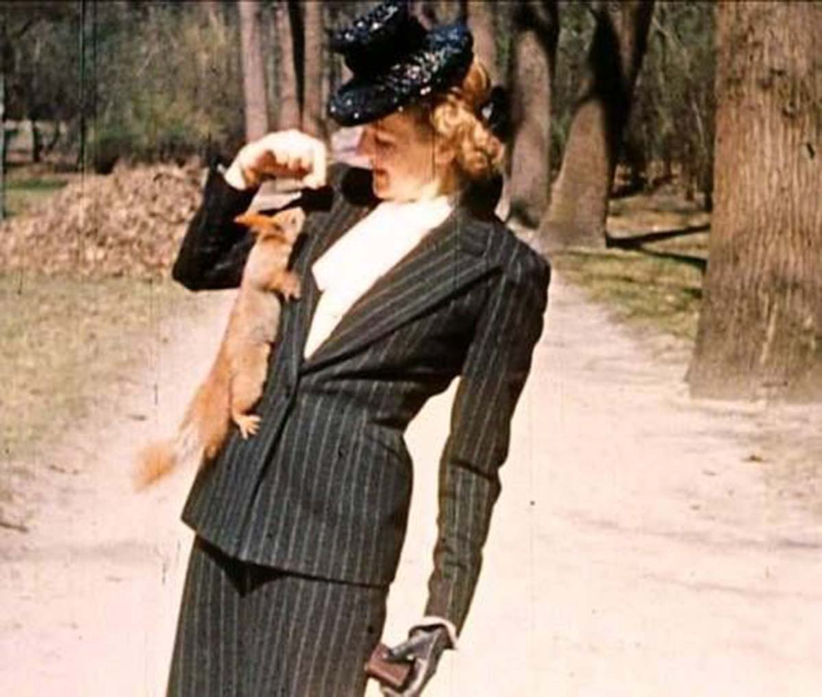 Eva Braun in a surprisingly modern-looking outfit. She loved to take pictures of herself and Adolf playing with local animals.
