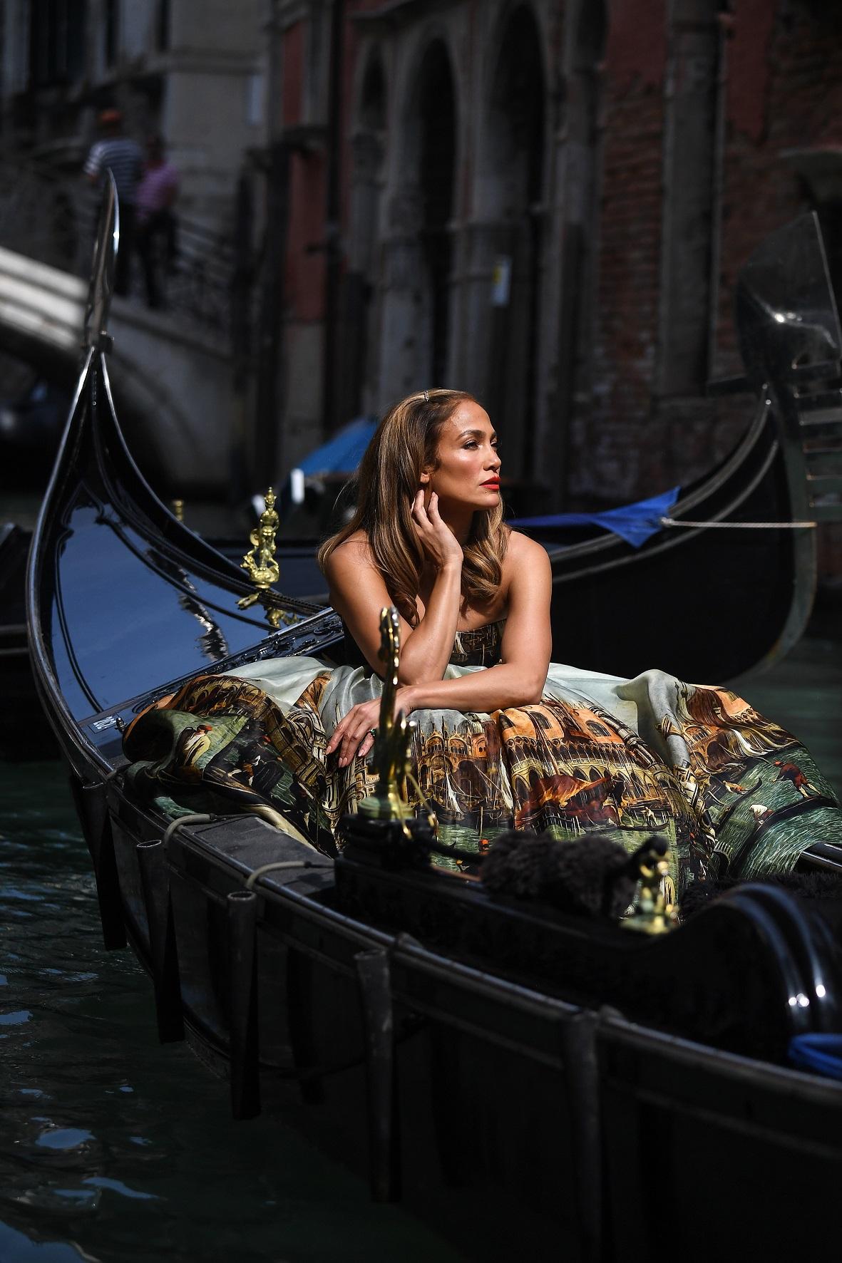 Jennifer Lopez climbs aboard a gondola ahead of a photoshoot for Dolce & Gabbana in Venice