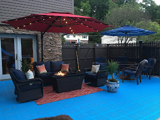 Greatmats pool deck tile with pool umbrellas for shade