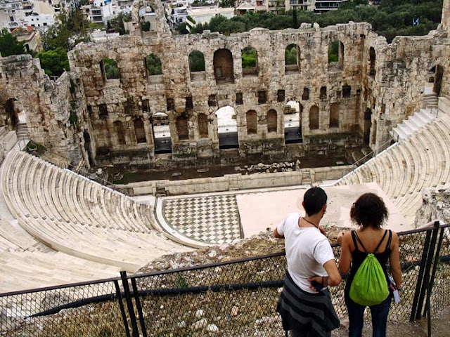 tourists at the ancient amphitheater in Athens