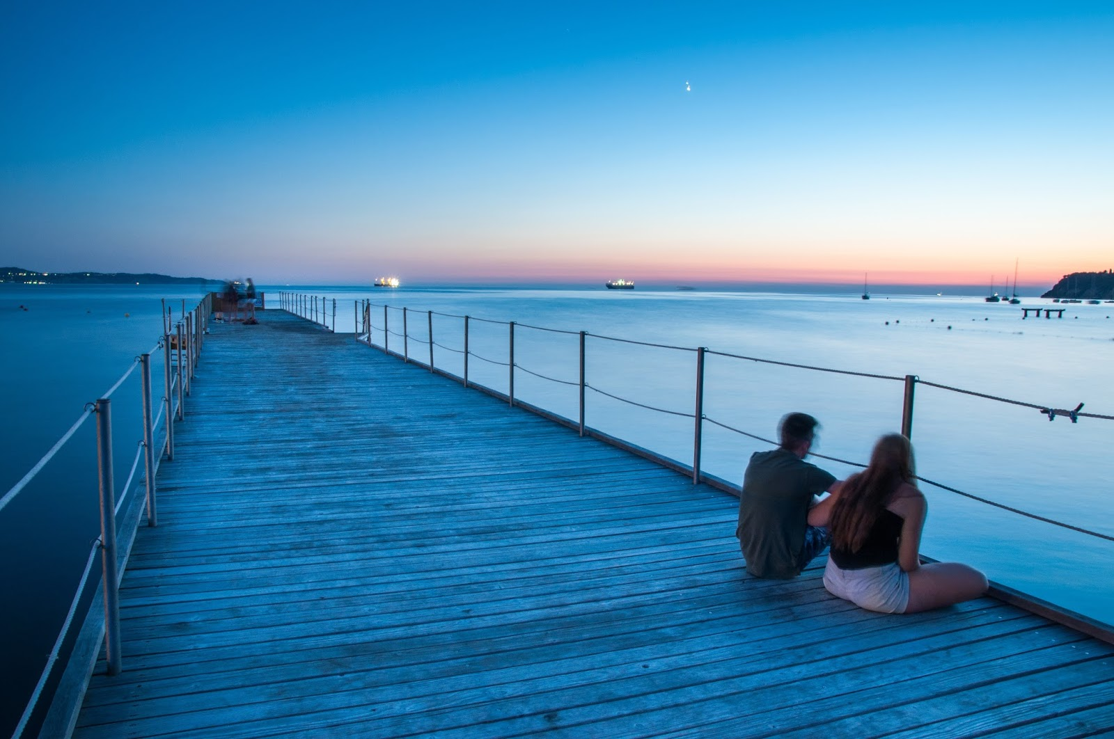 Couple on a pier at sunset