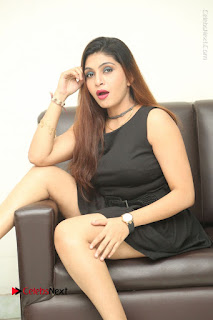 Tollywood Upcoming Actress Pooja Roshan Stills in Black Short Dress at Plus 1 Movie Trailer Launch  0264.JPG