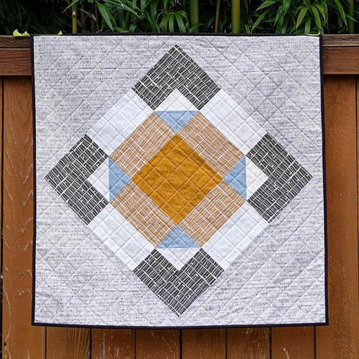 March Giant Block Quilt Free Tutorial Designed by Erica of Kitchen Table Quilting
