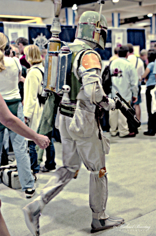 Star Wars Boba Fett cosplayer, Comic-Con International, San Diego Convention Center, Marina District, San Diego, California. Nikon n90s SLR camera. Fujifilm NPZ800 color negative 35mm film.