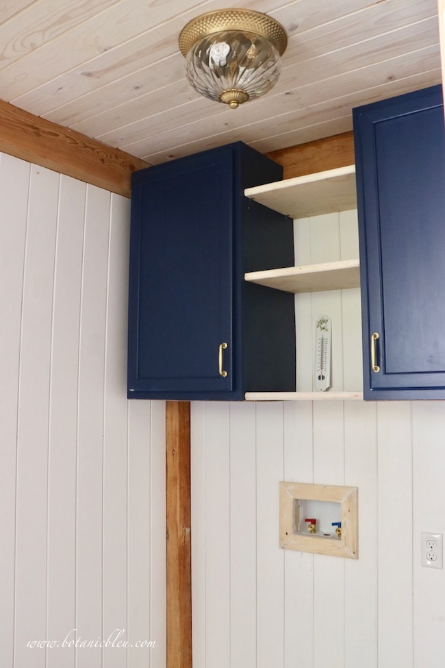 French Country laundry ORC French Style new navy cabinets with open shelves