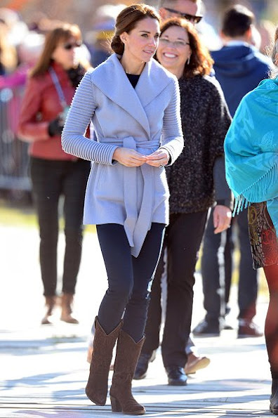 Kate Middleton wore a Ribbed Sleeves Wrapped Coat by Canadian designer Sentaler and new red coat by Venezeulan-American fashion designer Carolina Herrera, Tod's pumps