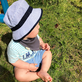 Jacob in the garden wearing Funky Giraffe bib