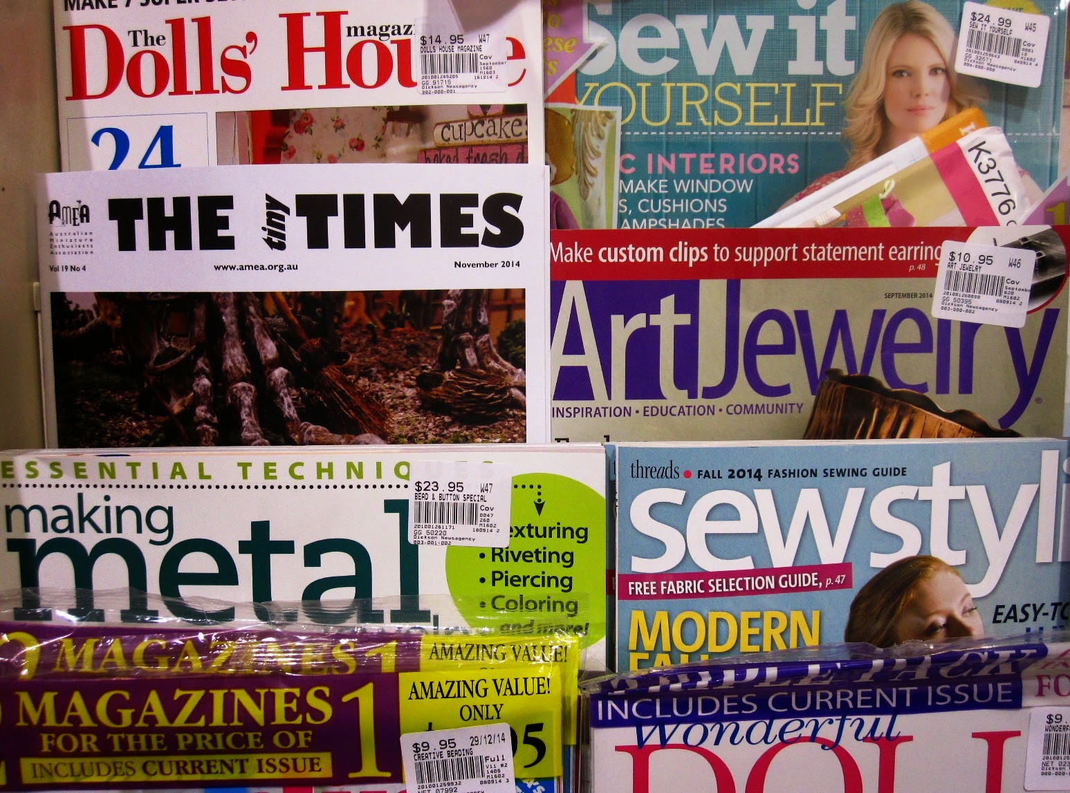 November issue of The tiny Times, displayed amongst the magazines at a newsagents.