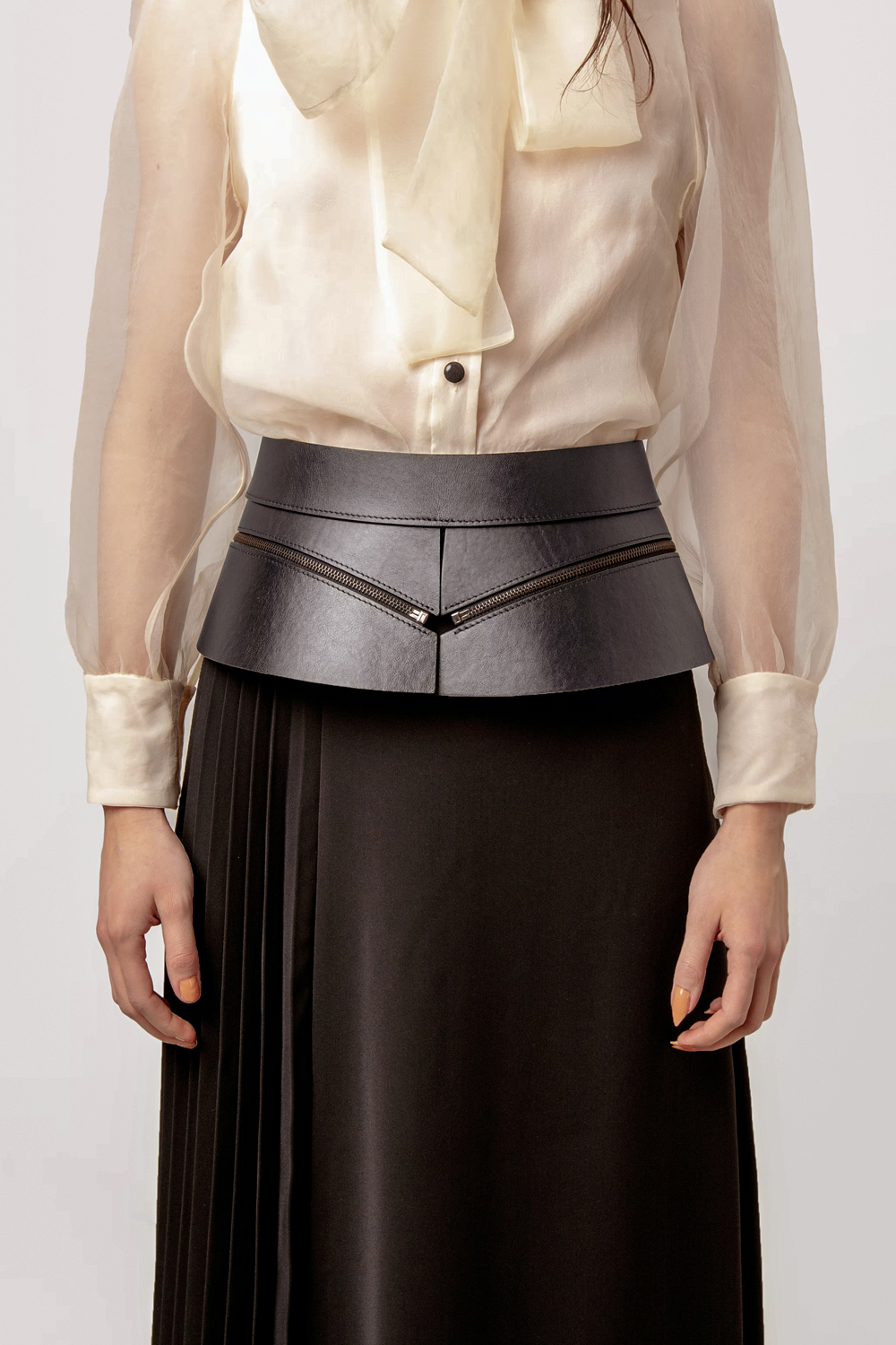 a close-up picture of a woman wearing statement belt