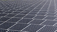 In this Wednesday, May 13, 2015 photo, some of the more than 37,000 solar panels gather sunlight at the Space Coast Next Generation Solar Center, in Merritt Island, Fla. (Credit: AP Photo/John Raoux) Click to Enlarge.