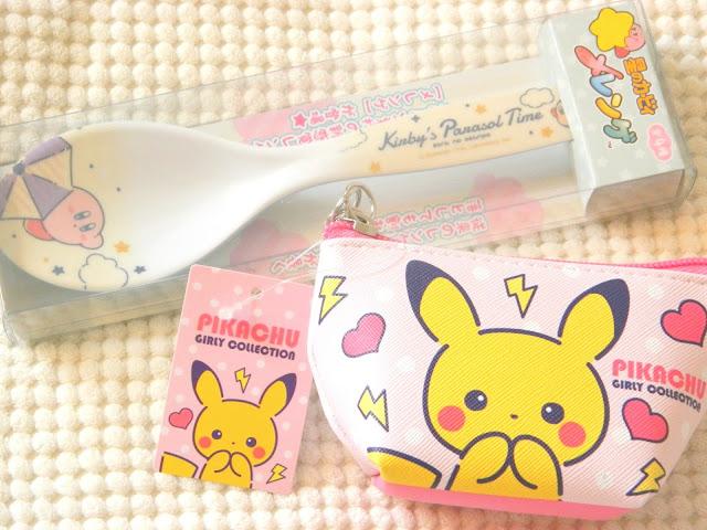 A photo showing a cute pikachu coin purse and a Kirby dessert spoon