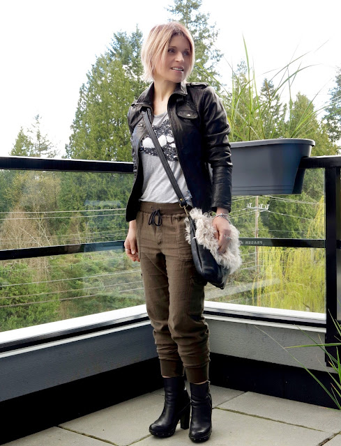 styling slouchy cargo pants with a sequinned t-shirt, motorcycle jacket, and platform booties