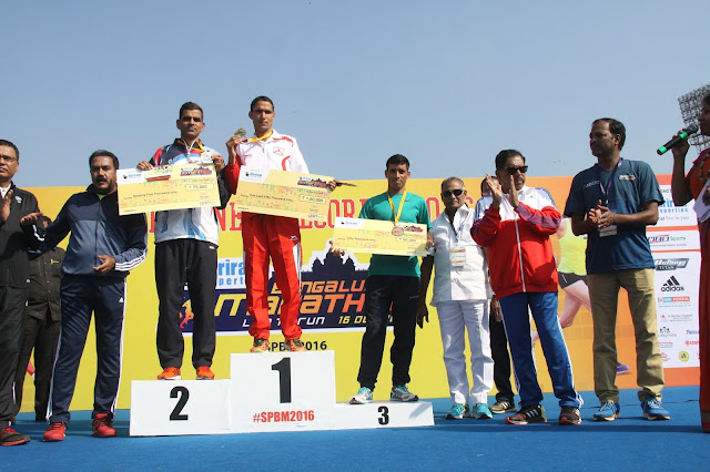 Winners at the podium (Full Marathon Elite Male): (L - R) SatyaBhan, Bahadur Dhoni and Hethram