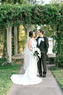 bride and groom photos in front of greenery