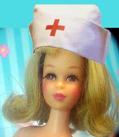 Ash-blond Francie doll with flipped up hair and a collaged old-fashioned nurse's cap with a red cross on her head