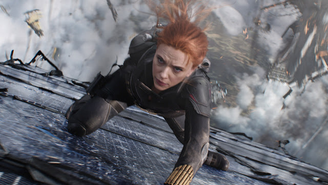 scarlett johansson hangs off a building or something