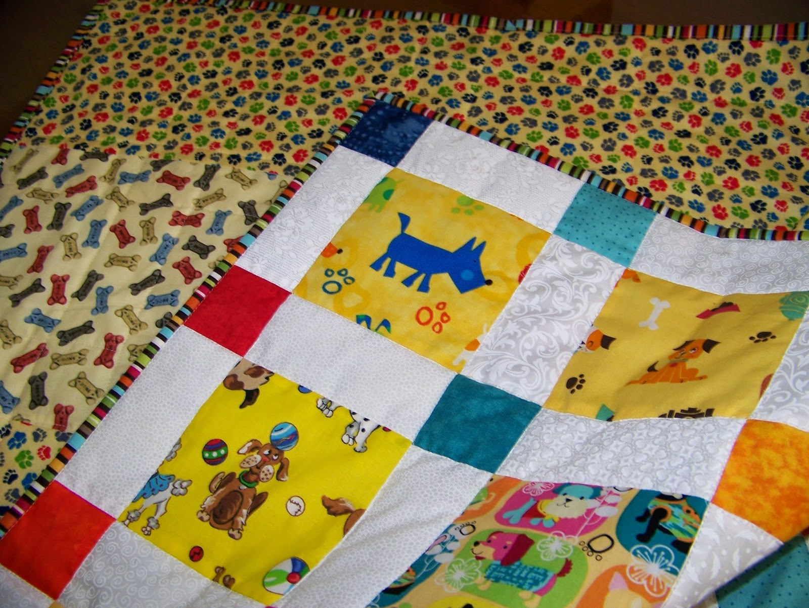 The Momoo Disappearing Nine Patch I Spy Baby Quilt