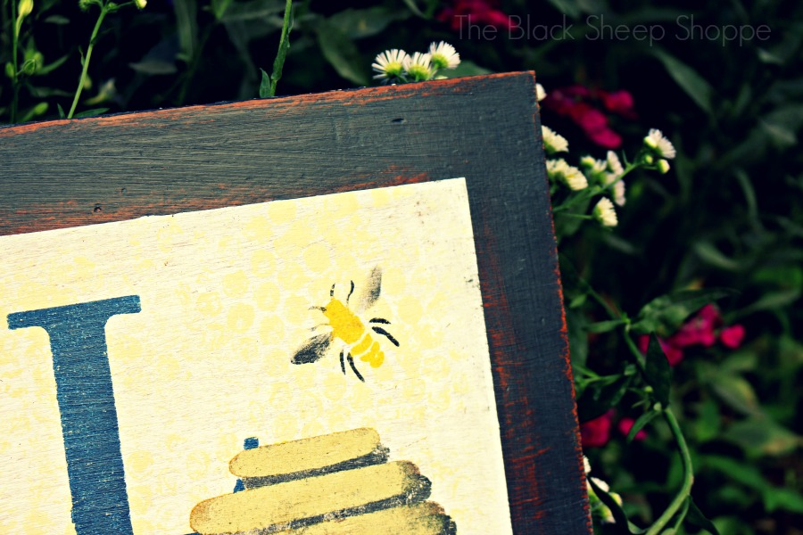 I stenciled the center of the bees in yellow. For the wings I used a light touch of black.
