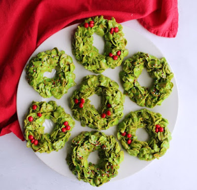 plate filled with no bake corn flake wreath cookies for Christmas