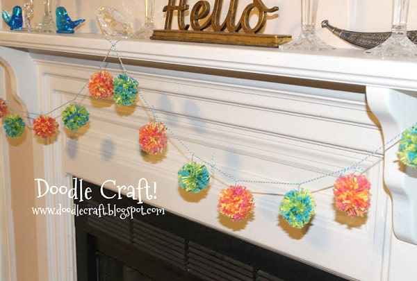 Turn pom-poms into a darling garland by stringing them with a needle and thread.