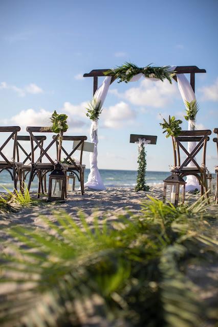 Photo of tropical beach wedding details
