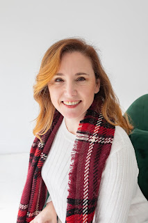 Photograph of Alynda before COVID-19 wearing a white sweater and red scarf suggesting a Christmas photo; Alynda's hair neatly combed and flowing down to her shoulders