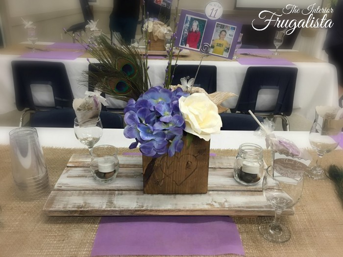 How to build rustic wooden table risers for wedding guest table centerpieces. A DIY budget wedding decor idea that is easy to make with fence boards.