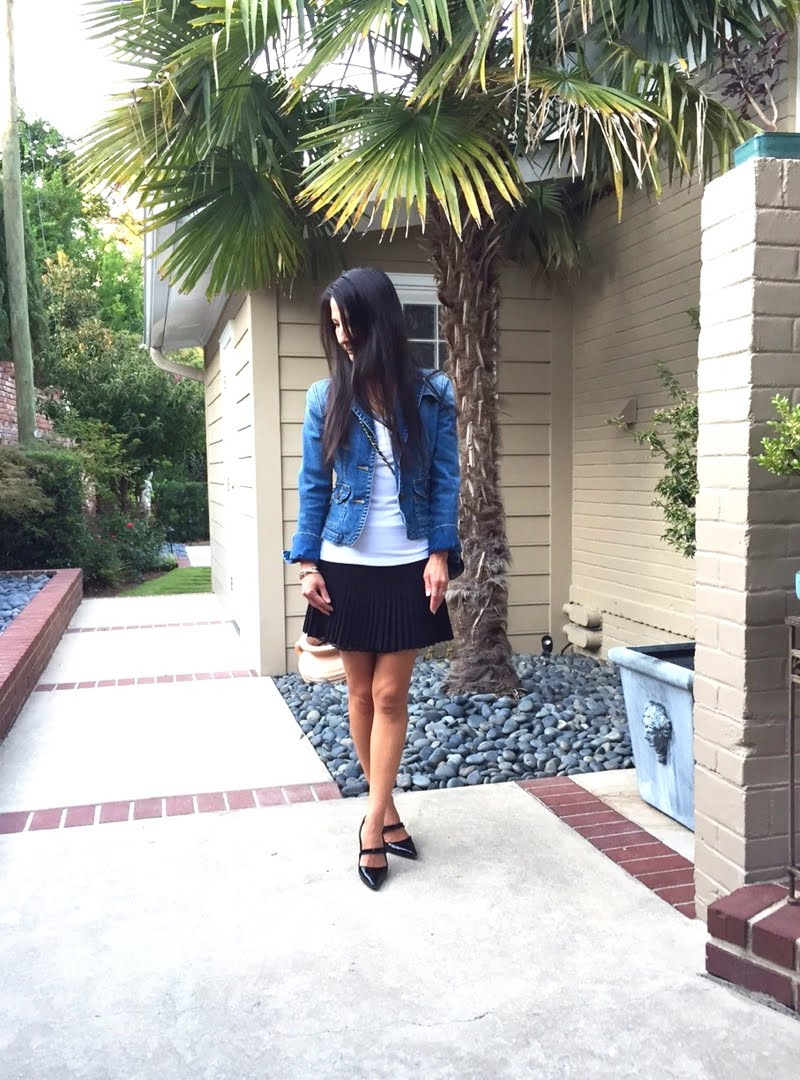 Denim and Black Outfit with head turned and hair in face.