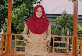Tessy Murdani, S.Pd