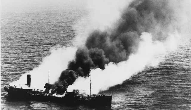 US tanker Harry F. Sinclair Jr. burns off Cape Lookout, North Carolina, 11 April 1942 worldwartwo.filminspector.com