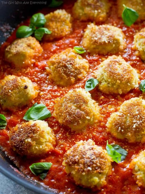 These Chicken Parmesan Meatballs are an Italian dinner that are ready in a snap. Seasoned meatballs with Panko crumbs for that crunch you crave with Chicken Parmesan. Serve over noodles with garlic bread and a salad for a delicious dinner.
