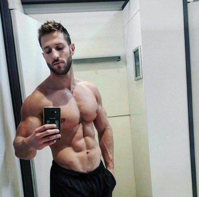 handsome-bearded-fit-man-bare-chest-huge-round-muscle-pecs-veiny-arms-selfie