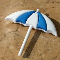 Blue and white umbrella brooch pin
