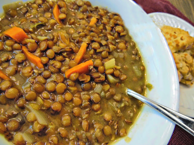 Bowl of homemade lentil soup with bread