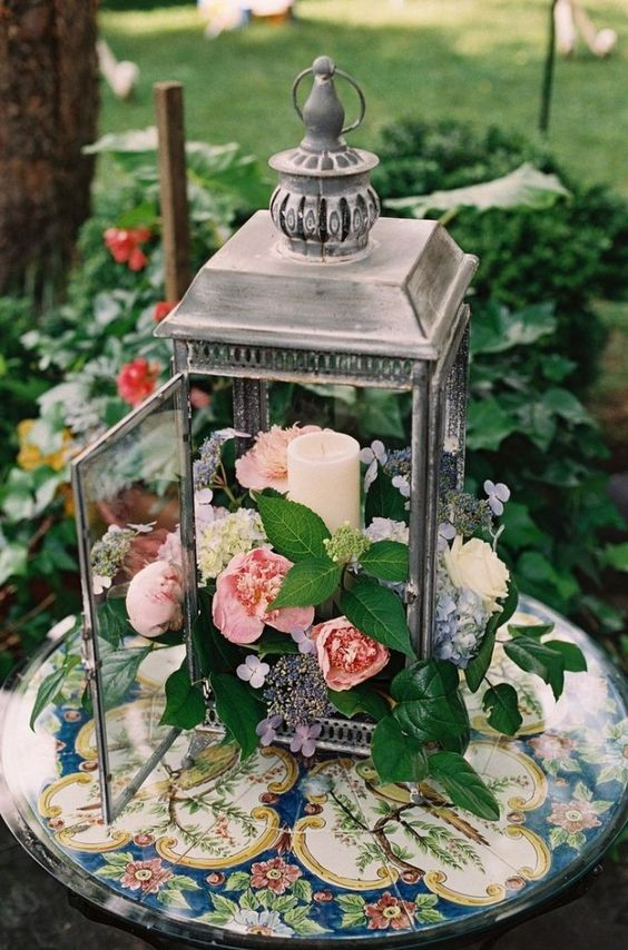 While Traditional Centerpieces Tend To Be Tall And Ont These Rustic Lantern Provide A Unique Change Are Perfect For Outdoor Weddings