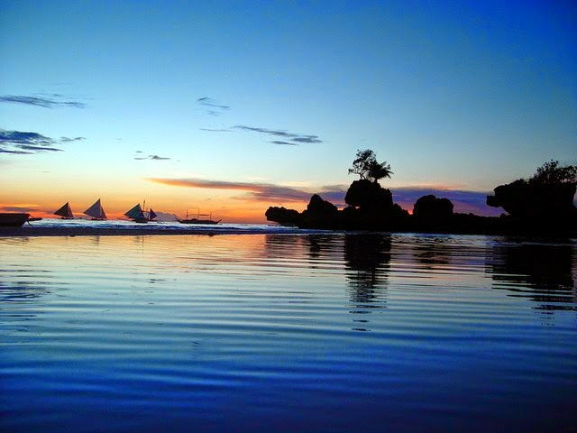 10 Most Famous Travel Destinations In Philippines | A view at dusk of Willy's Rock at Boracay Beach,Philippines