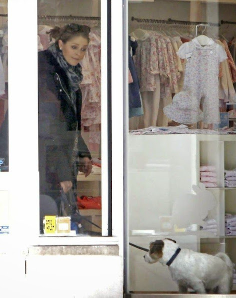Princess Madeleine shops for her newborn daughter Leonore with dog Zorro.