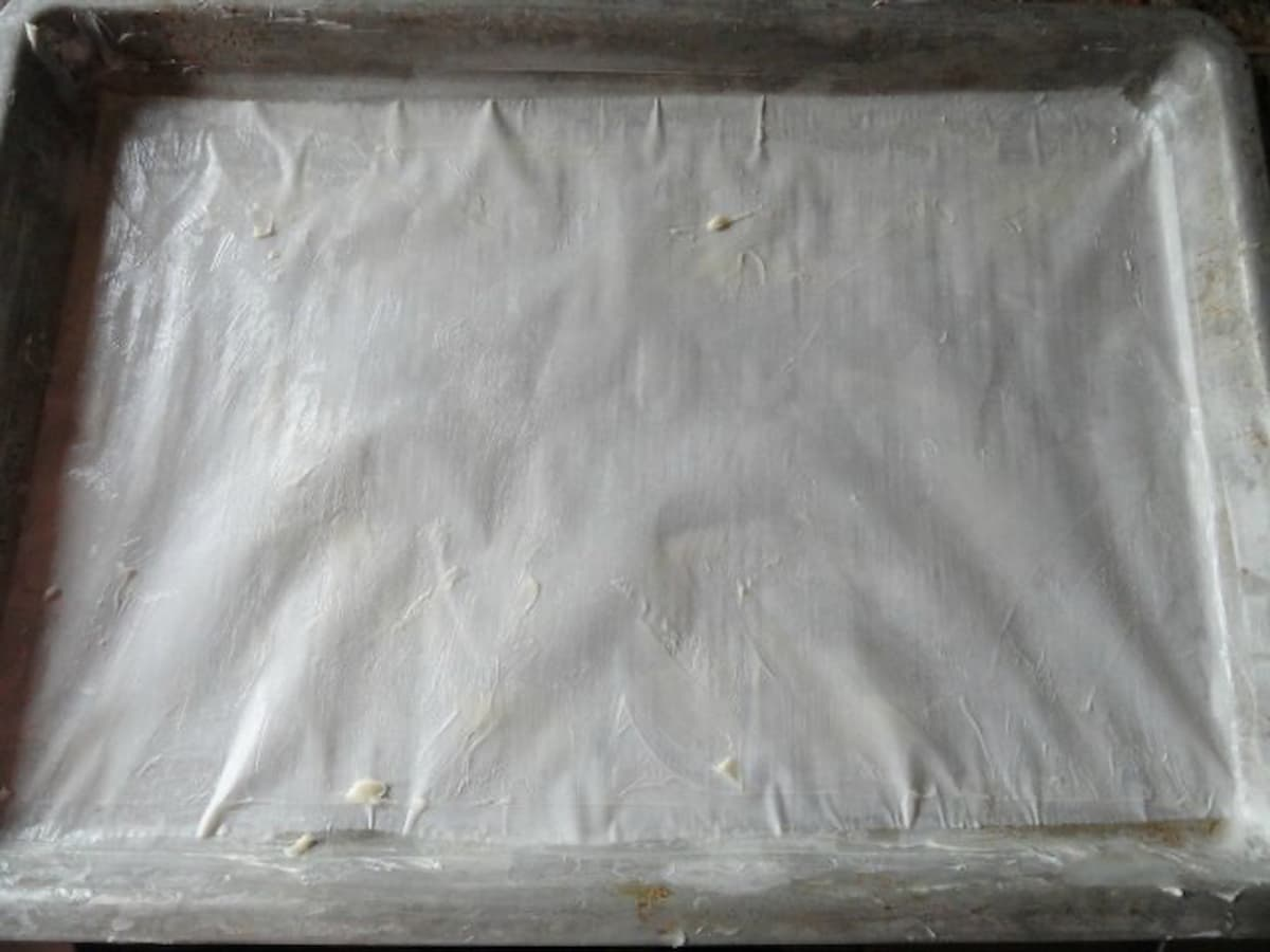 "A greased 15""x10""x1"" pan lined with parchment paper for Cinnamon Rock Candy."