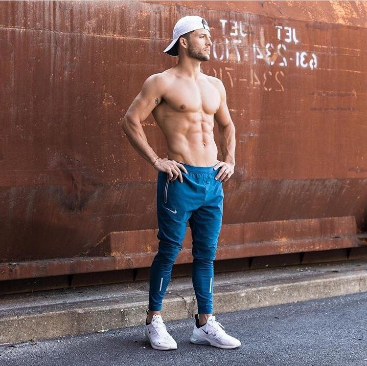 fit-shirtless-male-runner-sixpack-abs-pecs-big-chest-baseball-cap-sneakers