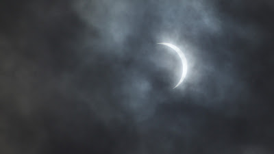 crescent sun in clouds