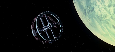 The Space Station orbitting Earth, used as transit to Moon, 2001: A space Odyssey (1968), Directed by Stanley Kubrick