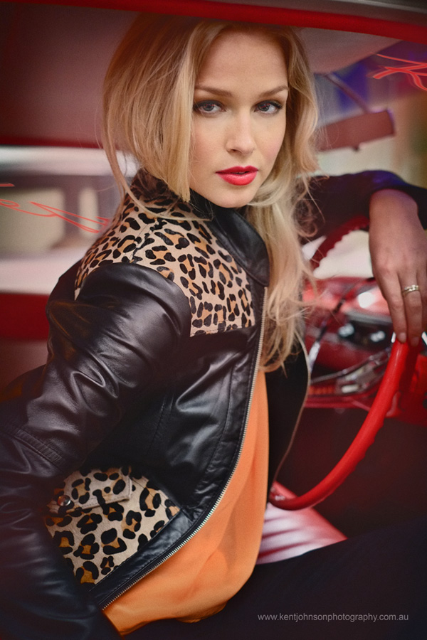 Renae Ayris behind the wheel, biker chic, Sydney fashion photoshoot with vintage Cadillacs, photographed by Kent Johnson.