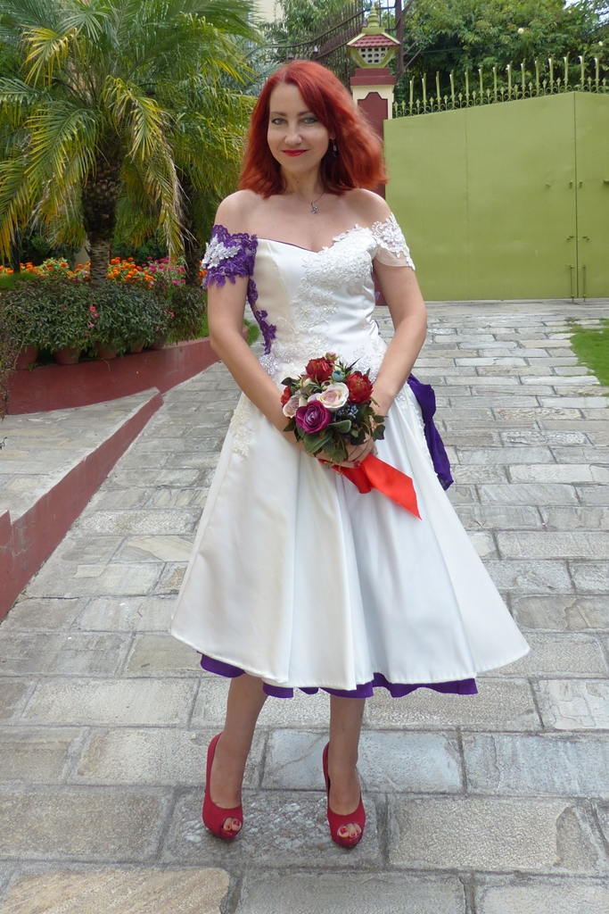 Ivory and purple wedding dress with lace, beads and sequins