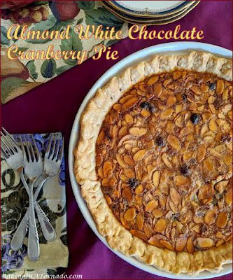 Almond White Chocolate Cranberry Pie. Warm seasonal flavors marry in this beautiful dessert, perfect for Thanksgiving or for Christmas. | Recipe developed by www.BakingInATornado.com | #recipe #dessert