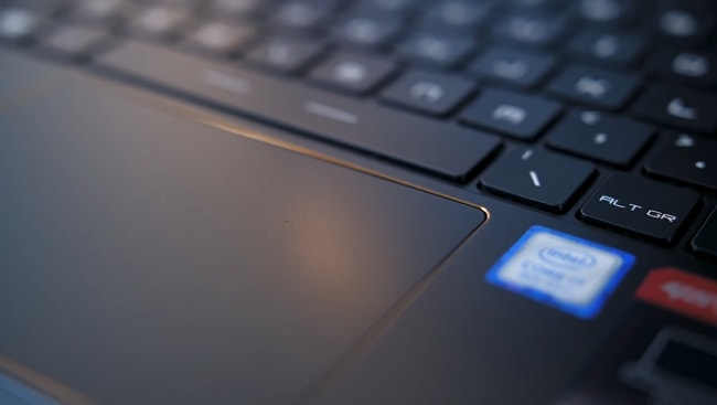The golden frame along the edges of the touchpad of this gaming laptop.