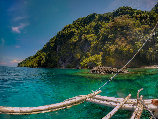 limasawa island, snorkeling, green mountain, aqua ocean, boat