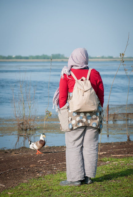 Preparing to feed the birds; Anzali Lagoon, Iran