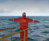 Oil rig worker by sea